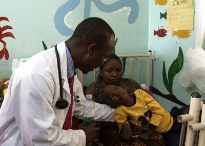 Child-Cancer-Patient-Wasswa-with-Dr-Henry-Ddungu-holding-Lidquid-Morphine_Kampala-Uganda