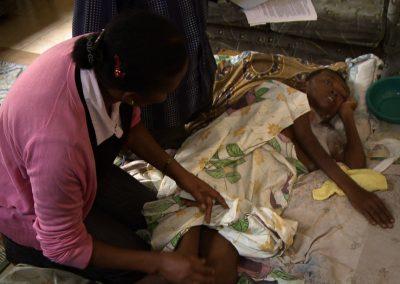 Nurse-Charlotte-Komunda-Treating-Cancer-Patient-Beatrice_Kampala-Uganda