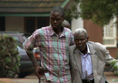 Son-Supports-Father-at-Hospice-Africa_Kampala-Uganda